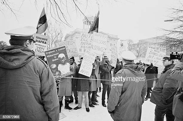 Demonstrators protest about the United Kingdom's involvement in the Biafran War during a visit from British Prime Minister Harold Wilson to Germany...