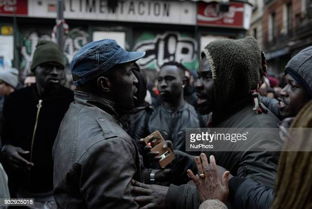 Demonstrators protest after the death of a Senegalese street vendor at the Lavapies neighborhood in Madrid on 16th March 2018 Yesterday clashes...