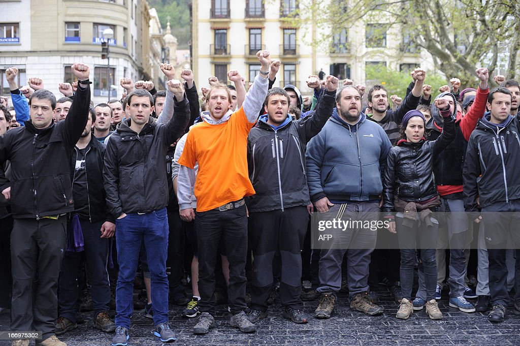 Demonstrators protest after the Ertzaintza Basque Police arrested six members of the Basque pro-independence youth organization SEGI in the northern Spanish Basque city of San Sebastian on April 19, 2013. Hundreds of people have remained gathered in San Sebastian during two days to try to prevent the incarceration of eight members of SEGI sentenced to six years in prison by the Supreme Court. The Spanish Court issued arrest warrants on April 16 against Mikel Arretxe, Imanol Vicente, Naikari Otaegi, Egoi Alberdi, Aitor Olaizola, Adur Fernandez, Oier Lorente y Ekaitz Ezkerra for membership in an organized armed group.