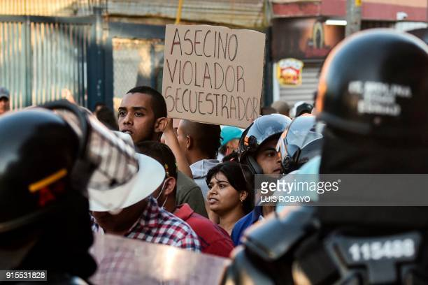 Demonstrators protest against a campaign rally held for Rodrigo Londono Echeverri known as 'Timochenko' the presidential candidate for the Common...