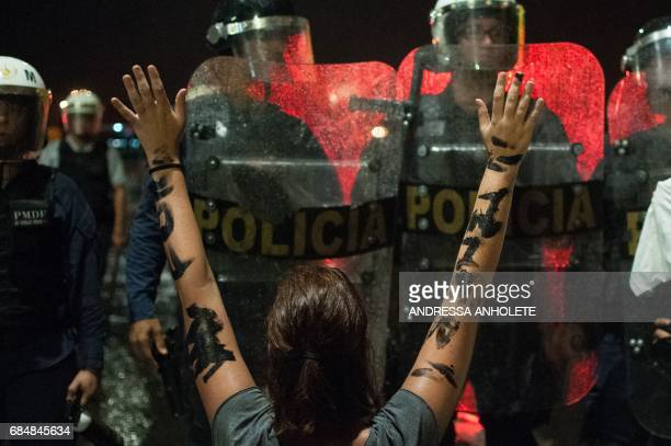 TOPSHOT Demonstrators protest against Brazilian President Michel Temer in front of the Planalto Palace in Brasilia on May 18 2017 Temer faced growing...