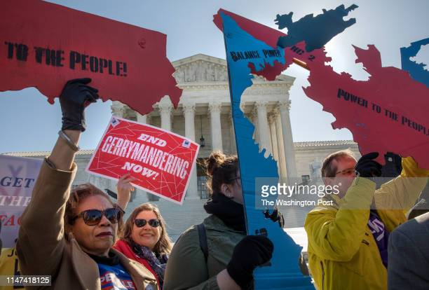 Demonstrators protest against gerrymandering at a rally at the Supreme Court during the gerrymandering cases Lamone v. Benisek and Rucho v. Common...