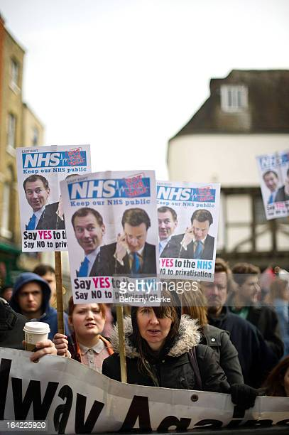 Demonstrators protest against government cuts to the National Health Service as guests arrive at the gates of Canterbury Cathedral for the...