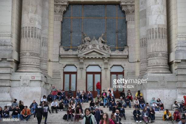 Demonstrators protest against Hungarian Prime Minister Viktor Orban's government in front of the former building of Hungarian Television on April 15...