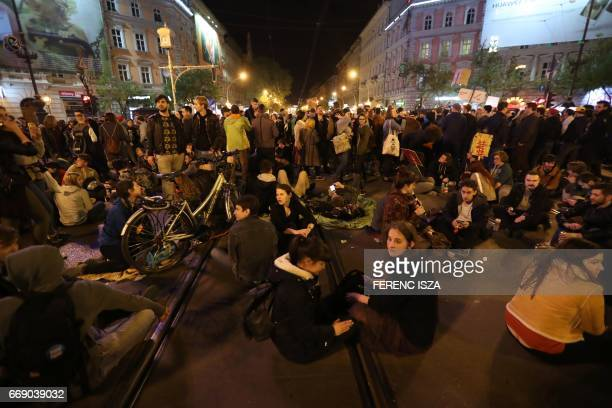 Demonstrators protest against Hungarian Prime Minister Viktor Orban's government on Oktogon square on April 15 2017 in downtown Budapest Thousands of...