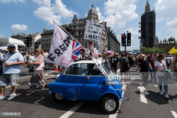 Demonstrators protest against lockdowns and Covid-19 vaccines in Parliament Square on the day of lifting of nearly all remaining coronavirus...