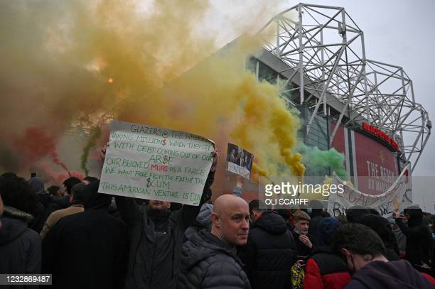Demonstrators protest against Manchester United's owners outside Old Trafford stadium in Manchester, north west England, on May 13 ahead of the...