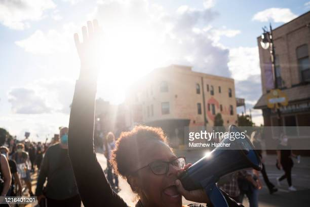 Demonstrators protest against police brutality for a second day following a night of confrontations between protesters and riot police on May 30,...