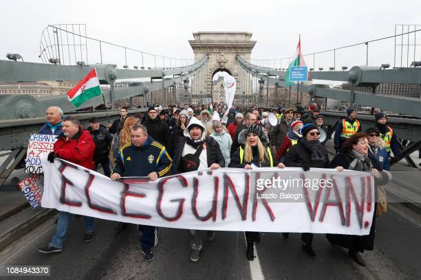 Demonstrators protest against recent legislative measures introduced by Hungarian Prime Minister Viktor Orban on January 19 2019 in Budapest Hungary...