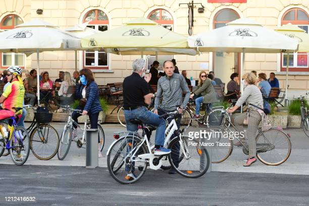 Demonstrators protest against the closure of the border of Transalpina square by bicycle because gatherings by foot are banned on the Slovenian side...