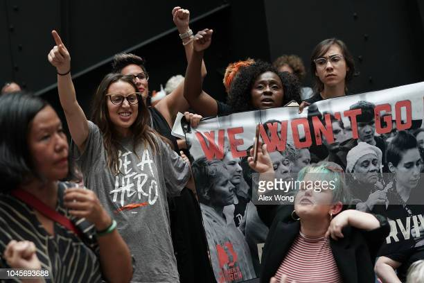 Demonstrators protest against the confirmation of Supreme Court nominee Judge Brett Kavanaugh October 4 2018 at the Hart Senate Office Building on...