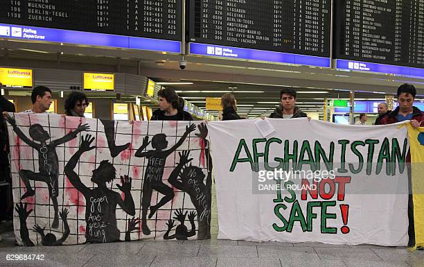 Demonstrators protest against the deportation of refugees back to Afghanistan at the airport in Frankfurt/Main Germany on December 14 2016 / AFP /...