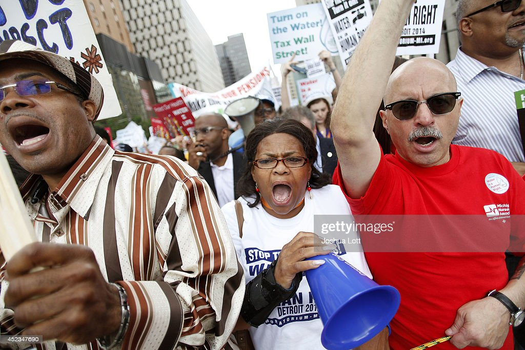 Demonstrators protest against the Detroit Water and Sewer Department July 18, 2014 in Detroit, Michigan. The Detroit Water and Sewer Department have disconnected water to thousands of Detroit residents who are delinquent with their bills.