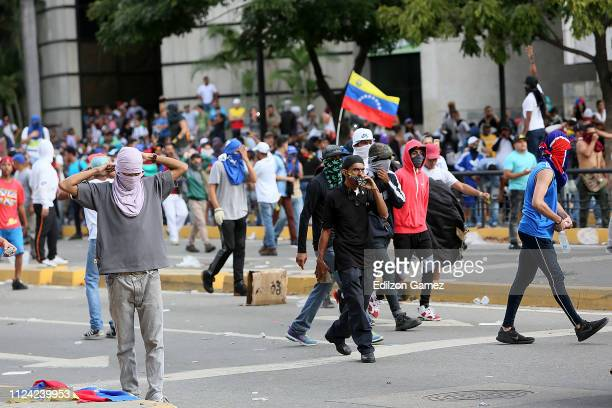 Demonstrators protest against the government of Nicolás Maduro before Venezuelan opposition leader and head of the National Assembly Juan Guaido...