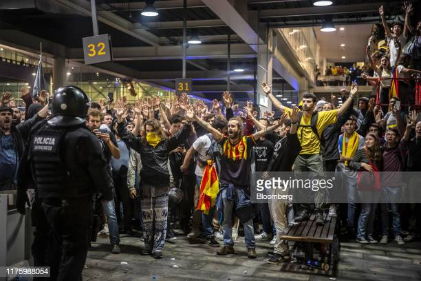 Demonstrators protest against the jailing of Catalan separatists at El Prat airport in Barcelona, Spain, on Monday, Oct. 14, 2019. Catalan...