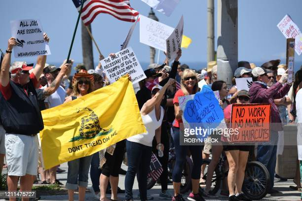 Demonstrators protest against the state's stayathome order amid the coronavirus pandemic on May 1 2020 in California