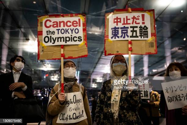Demonstrators protest against the Tokyo Olympics outside the building of the Tokyo Organising Committee of the Olympic and Paralympic Games on March...