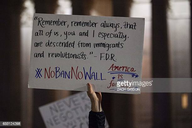 Demonstrators protest against US President Donald Trump and his administration's ban of travelers from 7 countries by Executive Order during a rally...