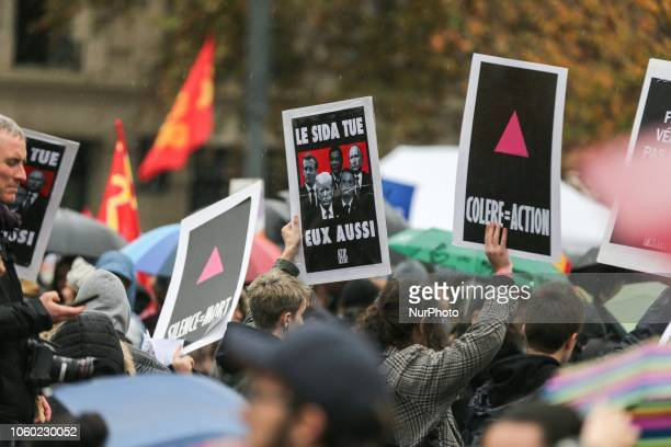 Demonstrators protest against US president Donald Trump at the Place de la Republique in central Paris on November 11 as leaders from around the...