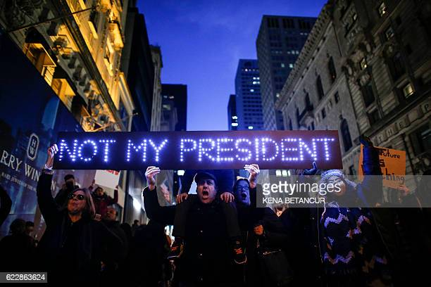 Demonstrators protest against US Presidentelect Donald Trump in front of Trump Tower on November 12 2016 in New York Americans spilled into the...