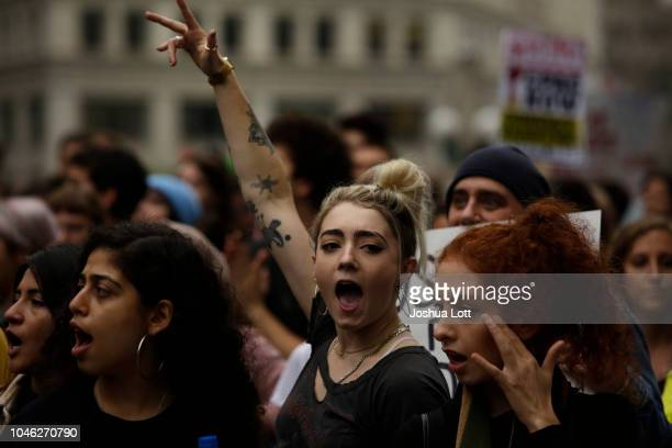 Demonstrators protest as they celebrate the verdict in the murder trial of Chicago police officer Jason Van Dyke along Wacker Drive on October 5 2018...