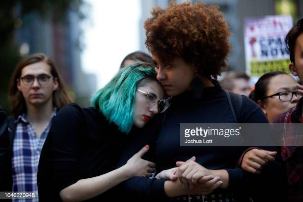 Demonstrators protest as they celebrate the verdict in the murder trial of Chicago police officer Jason Van Dyke along Michigan Avenue on October 5...