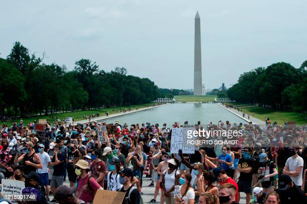 Demonstrators protest at Lincoln Memorial near the Washington Monument during a protest against police brutality and racism, on June 6, 2020 in...