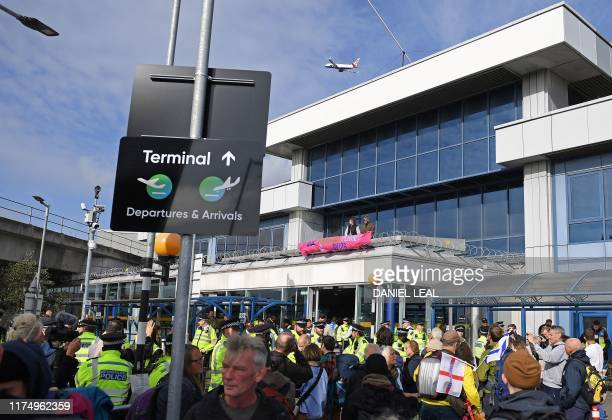 Demonstrators protest at London City Airport during the fourth day of demonstrations by the climate change action group Extinction Rebellion, in...