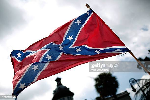Demonstrators protest at the South Carolina State House calling for the Confederate flag to remain on the State House grounds June 27 2015 in...