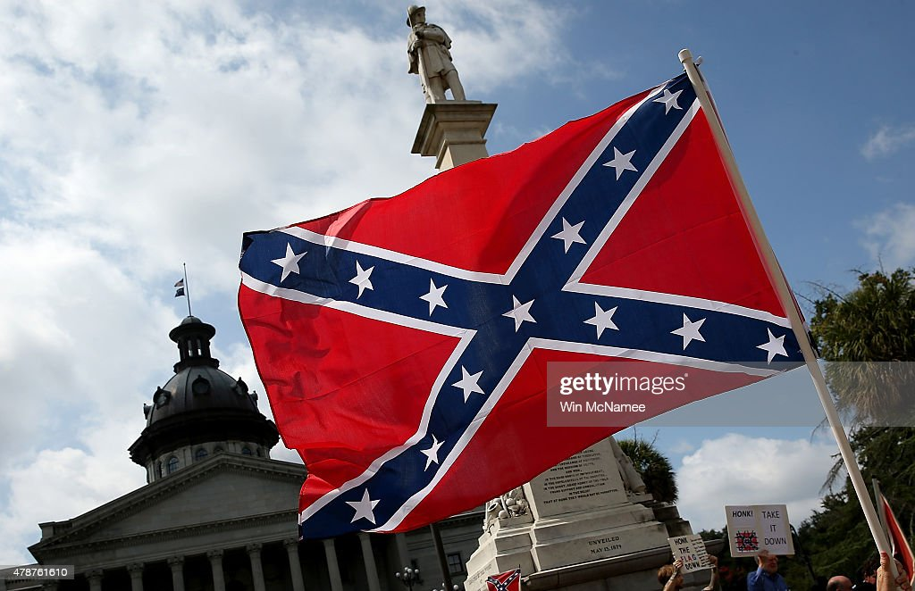 Demonstrators protest at the South Carolina State House calling for the Confederate flag to remain on the State House grounds June 27, 2015 in Columbia, South Carolina. Earlier in the week South Carolina Gov. Nikki Haley expressed support for removing the Confederate flag from the State House grounds in the wake of the nine murders at Mother Emanuel A.M.E. Church in Charleston, South Carolina.