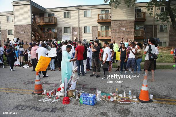 Demonstrators protest at the spot where teenager Michael Brown was killed on August 14, 2014 in Ferguson, Missouri. Brown was shot and killed by a...