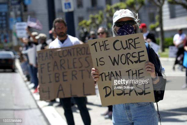 Demonstrators protest California Gov. Gavin Newsom's continued statewide shelter in place order outside of San Francisco City Hall on May 01, 2020 in...