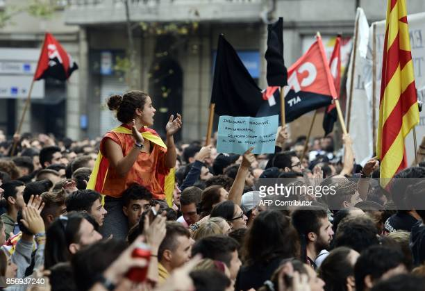 Demonstrators protest called by CNT union in front of the Catalan Popular Party headquarters during a general strike in Catalonia called by Catalan...