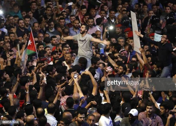 Demonstrators protest during a demonstration near the prime minister's office in Amman Jordan on June 6 2018 Jordanian Prime Minister Hani Mulki...