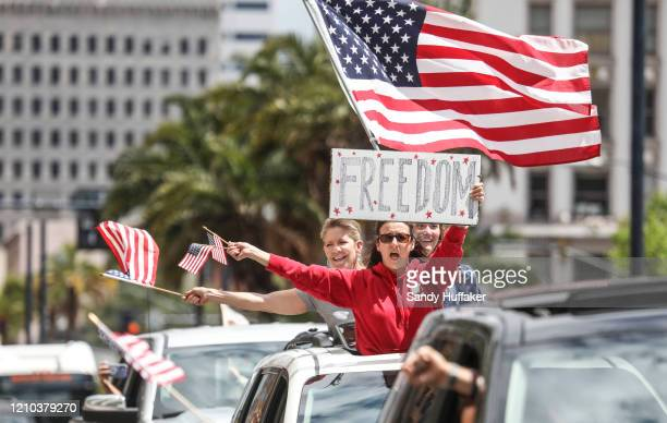 """Demonstrators protest during a """"Freedom Rally"""" against Stay-At-Home Directives on April 18, 2020 in San Diego, California. Rallies were held at..."""