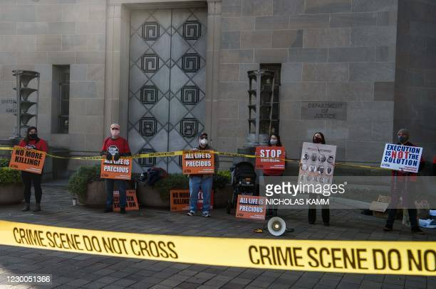 Demonstrators protest federal executions of death row inmates, in front of the US Justice Department in Washington, DC, on December 10, 2020. - US...