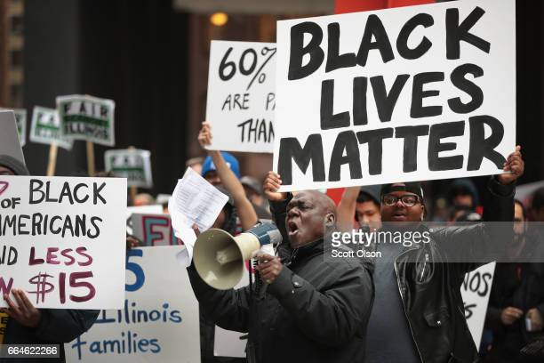 Demonstrators protest for higher wages and better working conditions on the 49th anniversary of the murder of Dr Martin Luther King Jr on April 4...