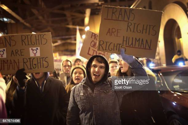 Demonstrators protest for transgender rights with a rally march through the Loop and a candlelight vigil to remember transgender friends lost to...