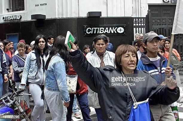 Demonstrators protest government measures on the economy in Buenos Aires Argentina 03 December 2001 Desocupados integrantes de la Corriente Clasista...