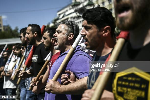 TOPSHOT Demonstrators protest in central Athens during a 24hour general strike on May 30 2018 Thousands of people protested in Greece on Wednesday as...