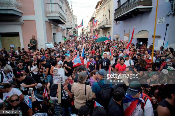 Demonstrators protest in front of the mansion of Puerto Rico's Governor Ricardo Rossello known as La Fortaleza in San Juan Puerto Rico on July 24...