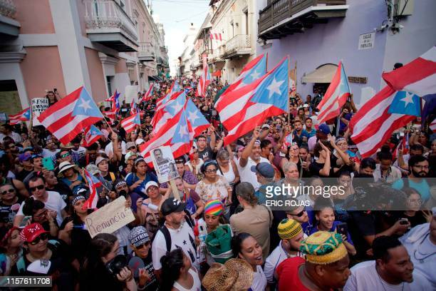 TOPSHOT Demonstrators protest in front of the mansion of Puerto Rico's Governor Ricardo Rossello known as La Fortaleza in San Juan Puerto Rico on...