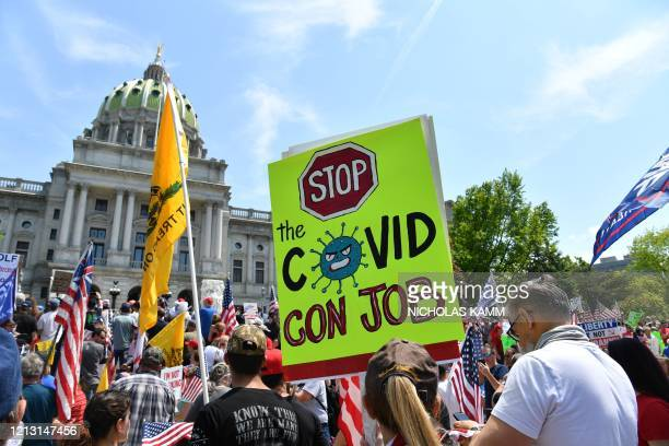 Demonstrators protest in Harrisburg Pennsylvania on May 15 demanding the reopening of the state and against Governor Tom Wolf's shutdown orders...