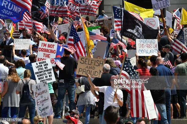 Demonstrators protest in Harrisburg, Pennsylvania, on May 15 demanding the re-opening of the state and against Governor Tom Wolf's shutdown orders...