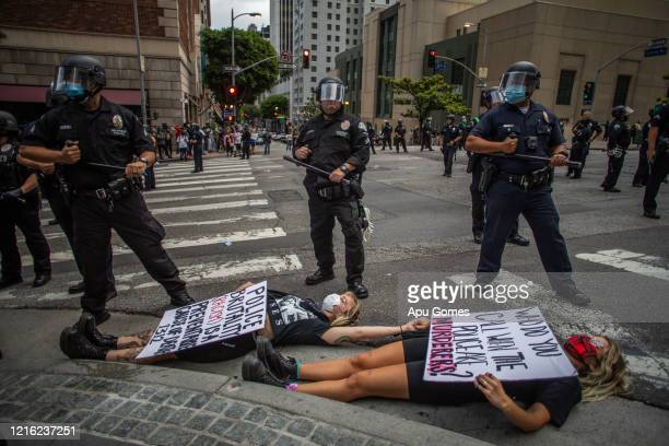 Demonstrators protest in response to the police killing of George Floyd on May 29 2020 in Los Angeles California Across country protests against...