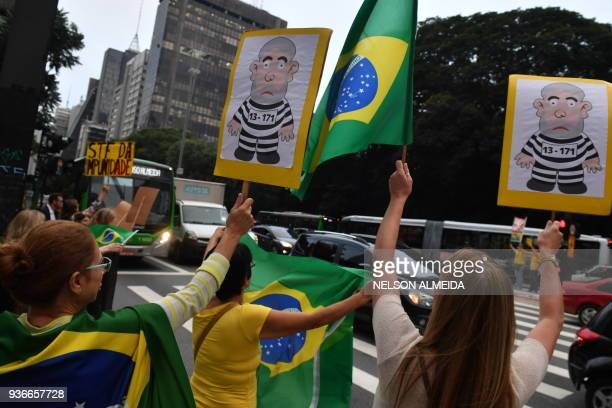 Demonstrators protest in Sao Paulo, Brazil on March 22 while the Supreme Court rules in the Brazilian capital, the Habeas Corpus that could prevent...