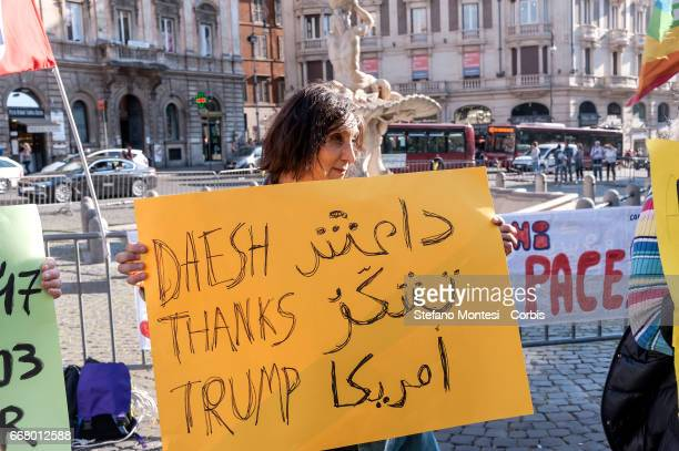 Demonstrators protest in solidarity with the Syrian people and against US military attack against Syria in Barberini Square on April 12 2017 in Rome...