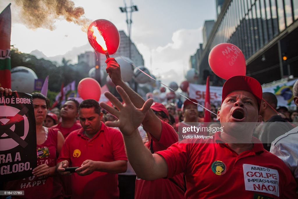 Demonstrators protest in support of former President Lula, investigated for money laundering on March 18, 2016, in Sao Paulo, Brazil. Former President Luiz Inacio Lula da Silva had his temporary detention requested by the prosecutor of Sao Paulo for alleged involvement in funding shifts and corruption. A telephone recording between President Dilma Rousseff and former President Lula was released by the Federal Police, which seems to suggest that he was appointed into the cabinet in an attempt to avoid prosecution in the corruption scandal.