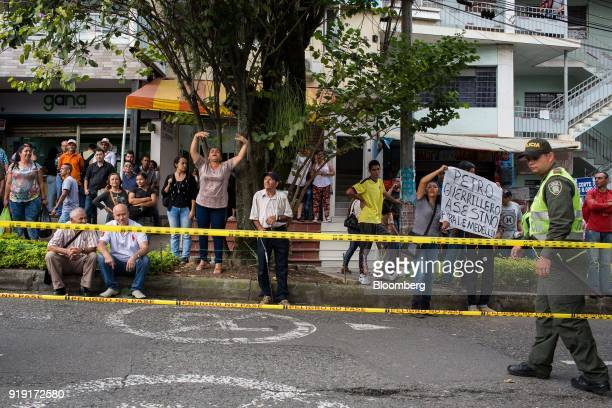 Demonstrators protest near a campaign rally for Gustavo Petro presidential candidate for the Progressivists Movement Party not pictured in Medellin...