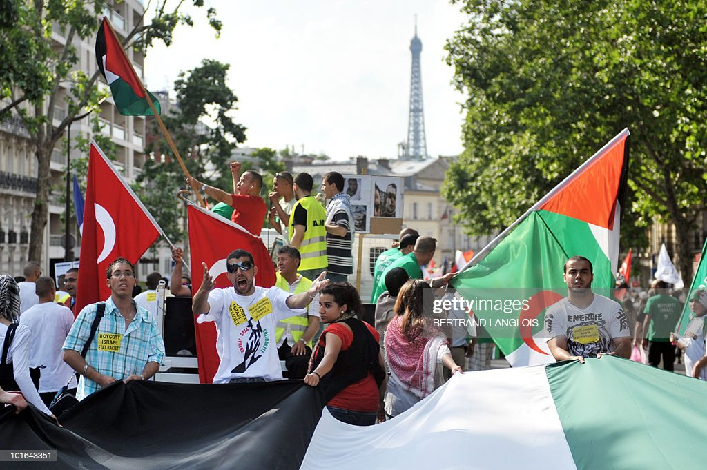 Demonstrators protest near the Eiffel Tower on June 5, 2010 in Paris streets against Israeli's storming of a Gaza-bound aid flotilla that left nine pro-Palestinian activits dead. The European Union will present in the coming days a proposal for lifting the Israeli blockade of Gaza, following the deadly raid this week on aid ships bound for the Palestinian territory, Spain's foreign minister said today.